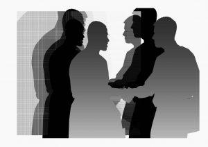 Mensen die elkaar de hand schudden