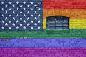 graffiti with the american flag and LGBTQ colors