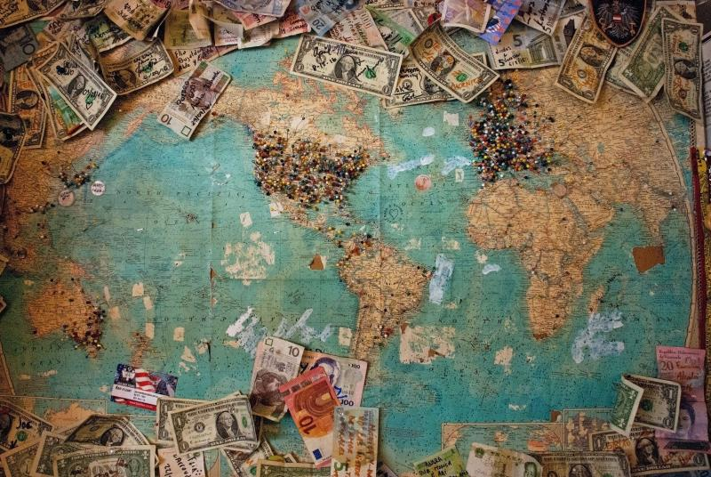 World map with banknotes