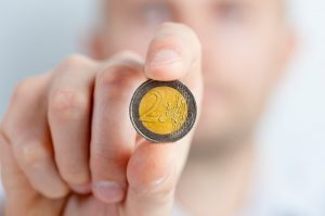 Person holding a coin