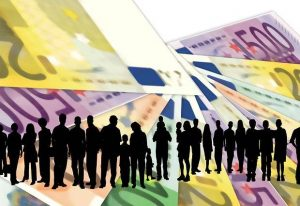 silhouette of people against background of banknotes